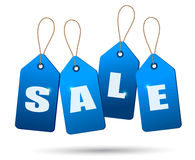 Blue sale tags. Concept of discount shopping. Stock Image