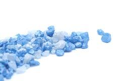 Blue salt. Blue spa salt isolated on white Stock Images