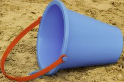 Blue Sand Bucket with red handle, Children`s Beach toy. Taken on the beach near Corpus Christi Texas stock photography