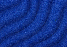 Blue sand waves texture as background Stock Images
