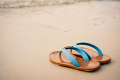 Blue sandal on the beach concept time to travel Stock Photography