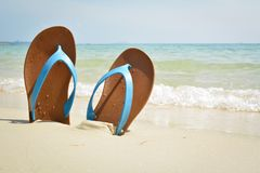 Blue sandal on the beach. Concept time to travel , holiday summer season Royalty Free Stock Images