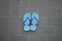 Blue sandal on brick floor royalty free stock photo