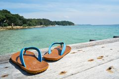 Blue sandal on wood bridge and sea background. Concept time to travel , holiday summer season Stock Photo