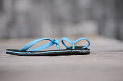 Blue sandal on the wooden walkway Stock Photos