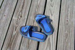Blue sandals. On the pier Stock Image