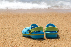 Blue sandals slippers on the sand Stock Photos
