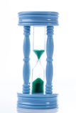 Blue sandclock on white background Royalty Free Stock Photos