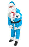 Blue Santa claus gives a present Stock Photography