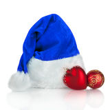 Blue Santa Claus hat and red Christmas toy Royalty Free Stock Photo