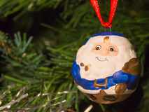 Blue santa claus shaped ball decoration on christmas tree Stock Images