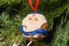 Blue santa claus shaped ball decoration on christmas tree Royalty Free Stock Photography