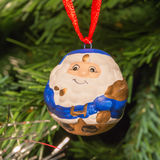 Blue santa claus shaped ball decoration on christmas tree Royalty Free Stock Photos