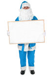 Blue Santa and empty bulletin board Stock Image