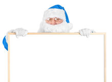 Blue Santa and empty white board Royalty Free Stock Photography