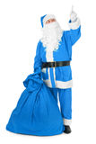Blue Santa pointing his finger at an object Royalty Free Stock Images