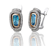 Blue sapphire earring isolated  Royalty Free Stock Image