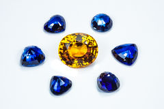 Blue sapphire and topaz. The topaz around with group of the blue sapphires Royalty Free Stock Photo