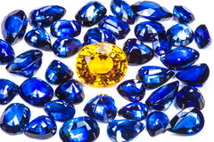 Blue sapphire and topaz. The topaz around with group of the blue sapphires Stock Photography