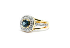 Blue Sapphire  with white diamond and gold ring Royalty Free Stock Photo
