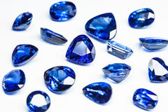 Blue sapphires. Group of blue sapphires with white background Stock Photos