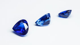 Blue sapphires. Three blue sapphires with white background Royalty Free Stock Photo