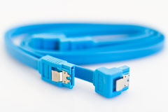 Blue SATA cables. On a white background Royalty Free Stock Photos