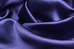 Blue Satin. A sheet of blue satin caressly draped Stock Photos