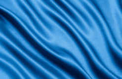 Blue satin. As a background, studio shot Royalty Free Stock Photography