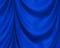 Blue Satin Background. Smooth, swirling waves of luxurious royal blue background drapes with shine and folds for depth Stock Photos