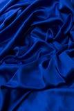 Blue satin background Stock Images