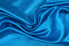 Blue satin background Stock Images