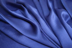 Blue satin cloth. A silky soft shining blue satin cloth with foldings Royalty Free Stock Photography