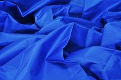 Blue satin fabric. Closeup of a blue satin fabric backdrop Stock Images