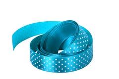 Blue satin ribbon. Isolated on white Stock Photo