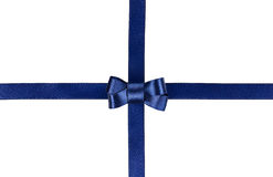 Blue satin ribbon tied in a bow isolated on white. Background Royalty Free Stock Image