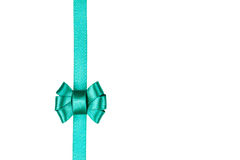 Blue satin ribbon tied in a bow isolated on white. Background Royalty Free Stock Photography