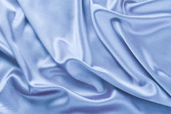 Blue satin or silk background Royalty Free Stock Photos