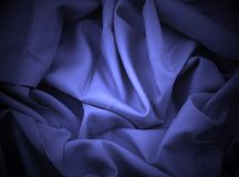 Blue satin with spotlight. Close-up of blue satin with spotlight Stock Photo