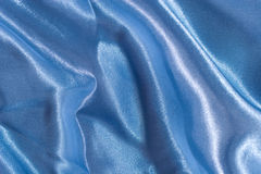 Blue satin texture. (as a background Stock Photography