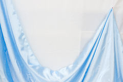 Blue satin on white Stock Photography