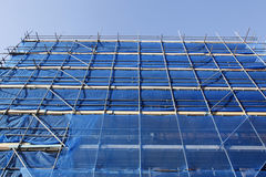 Blue scaffolding and blue sky Stock Photo