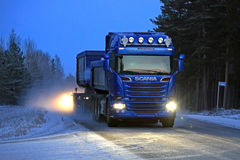 Blue Scania Combination Vehicle on a Winter Night stock photos