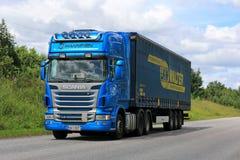 Blue Scania R440 Semi Trailer Transport at Summer. SALO, FINLAND - JULY 8, 2016: Blue Scania R440 semi truck of Kuljetusliike Markus Hanninen hauls curtainsider Stock Photos