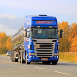Blue Scania R440 Tank Truck on Autumn Highway. LIETO, FINLAND - OCTOBER 4, 2014: Blue Scania R440 tank truck transports chemicals. According to Cefic, The EU Royalty Free Stock Images