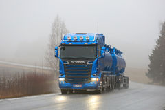 Blue Scania R580 Tank Truck on Foggy Road Royalty Free Stock Photo