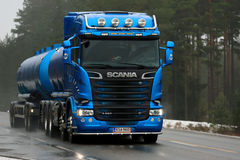 Blue Scania R580 Tank Truck in Foggy Weather Stock Photos