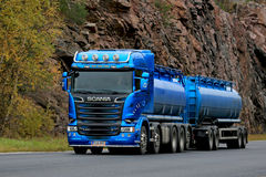 Blue Scania R580 Tank Truck on the Road. KARJAA, FINLAND - OCTOBER 15, 2016: Metallic blue Scania R580 tank truck moves along highway in autumn, background of Stock Photo