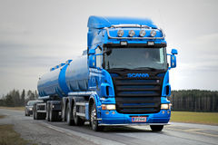 Blue Scania R500 Tank Truck on the Road. SALO, FINLAND - MARCH 22, 2015: Blue Scania R500 tank truck on the road. Scania publishes Sustainability Report 2014 Stock Photo