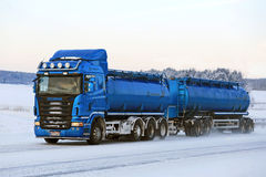 Blue Scania R500 Tank Truck on the Road in Winter Weather Stock Image